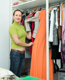Housewife checking apparel at home Royalty Free Stock Image