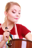 Housewife chef in kitchen apron with pot soup Stock Photos