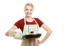 Housewife or chef in kitchen apron with skillet frying pan Stock Photo