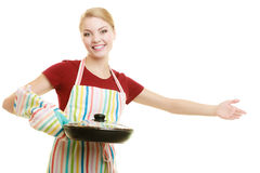 Housewife or chef in kitchen apron with skillet frying pan Royalty Free Stock Photography
