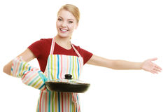 Housewife or chef in kitchen apron with skillet frying pan Stock Image