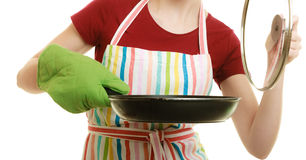 Housewife or chef in kitchen apron with skillet frying pan Royalty Free Stock Photos