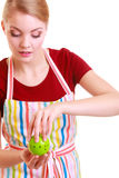 Housewife or chef in kitchen apron using apple timer isolated Royalty Free Stock Images