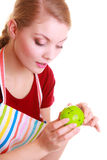 Housewife or chef in kitchen apron using apple timer isolated Royalty Free Stock Photo