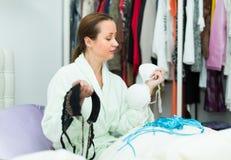 Housewife choosing underwear Stock Image