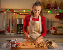 Housewife chopping walnuts in christmas kitchen Royalty Free Stock Photo
