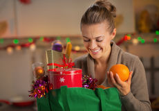 Housewife with christmas shopping bag royalty free stock images
