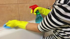 Housewife clean bath with blue brush stock video