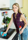 Housewife cleaning electric panel Royalty Free Stock Photos