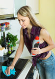 Housewife cleaning electric panel Stock Image