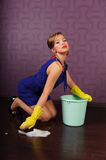 Housewife is cleaning the floor Royalty Free Stock Photos