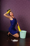 Housewife is cleaning the floor Royalty Free Stock Photo