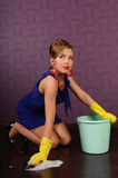 Housewife is cleaning the floor Stock Photos