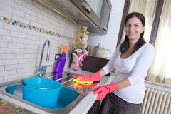 Housewife cleaning furniture in the kitchen Royalty Free Stock Photography
