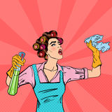 Housewife Cleaning the House with Spray and Rag. Pop Art. Vector Royalty Free Stock Photo
