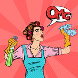 Housewife Cleaning the House with Spray and Rag. Pop Art. Vector Stock Images