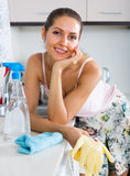 Housewife cleaning on the kitchen Royalty Free Stock Image