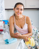 Housewife cleaning on the kitchen Stock Photos