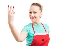 Housewife or cleaning lady showing number three. With fingers smiling on white background Stock Photo