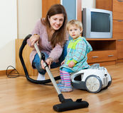 Housewife  cleaning living room with vacuum cleaner Stock Photo