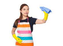 Housewife cleaning by rag with plastic gloves Stock Photos