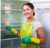 Housewife cleaning refrigerator Royalty Free Stock Photography
