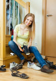 Housewife cleaning shoes at home Stock Photography