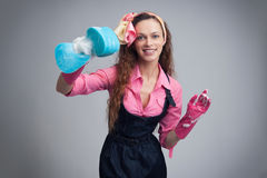 Housewife with cleaning sponge Royalty Free Stock Photography