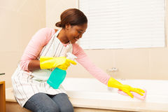 Housewife cleaning up bathtub Stock Photos