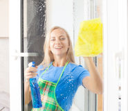 Housewife cleaning window Royalty Free Stock Image