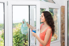 Housewife cleaning windows Stock Photos