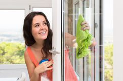 Housewife cleaning windows Royalty Free Stock Photography