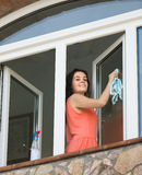 Housewife cleaning windows Royalty Free Stock Photos