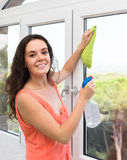 Housewife cleaning windows Stock Photography