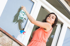 Housewife cleaning windows Royalty Free Stock Images
