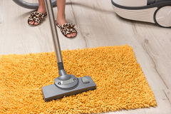 Housewife cleans the carpet. Stock Photography