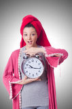 Housewife with clock  Stock Photo