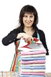 Housewife close to towels stacked Stock Photo