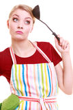 Housewife cook chef in kitchen apron with ladle Royalty Free Stock Photography
