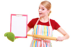 Housewife or cook in kitchen apron holds clipboard with empty blank isolated Stock Image