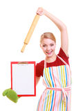 Housewife or cook in kitchen apron holds clipboard with empty blank isolated Royalty Free Stock Images