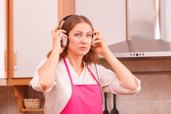 Housewife cook in kitchen Royalty Free Stock Photos