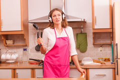 Housewife cook in kitchen Stock Photography