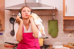 Housewife cook in kitchen Stock Photos