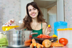 Housewife cook with oil Stock Image