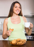 Housewife with cookies in kitchen Royalty Free Stock Photo
