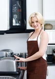 Housewife cooking Stock Photo