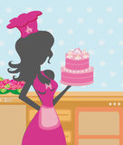 Housewife cooking cake Stock Photography