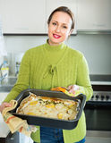 Housewife cooking filleted fish Royalty Free Stock Photos
