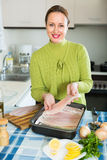Housewife cooking filleted fish Stock Photo